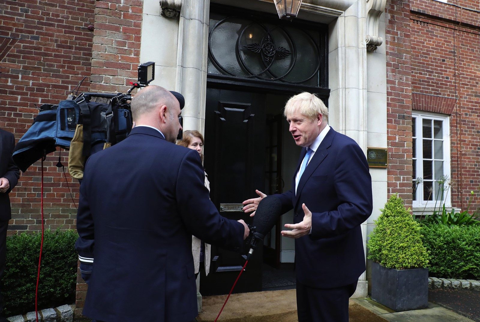British Prime Minister Boris Johnson arrives at Stormont House in Belfast, Northern Ireland. He suggested he might be able to help end party discord. — Photograph: Kelvin Boyles/Pool Photo.