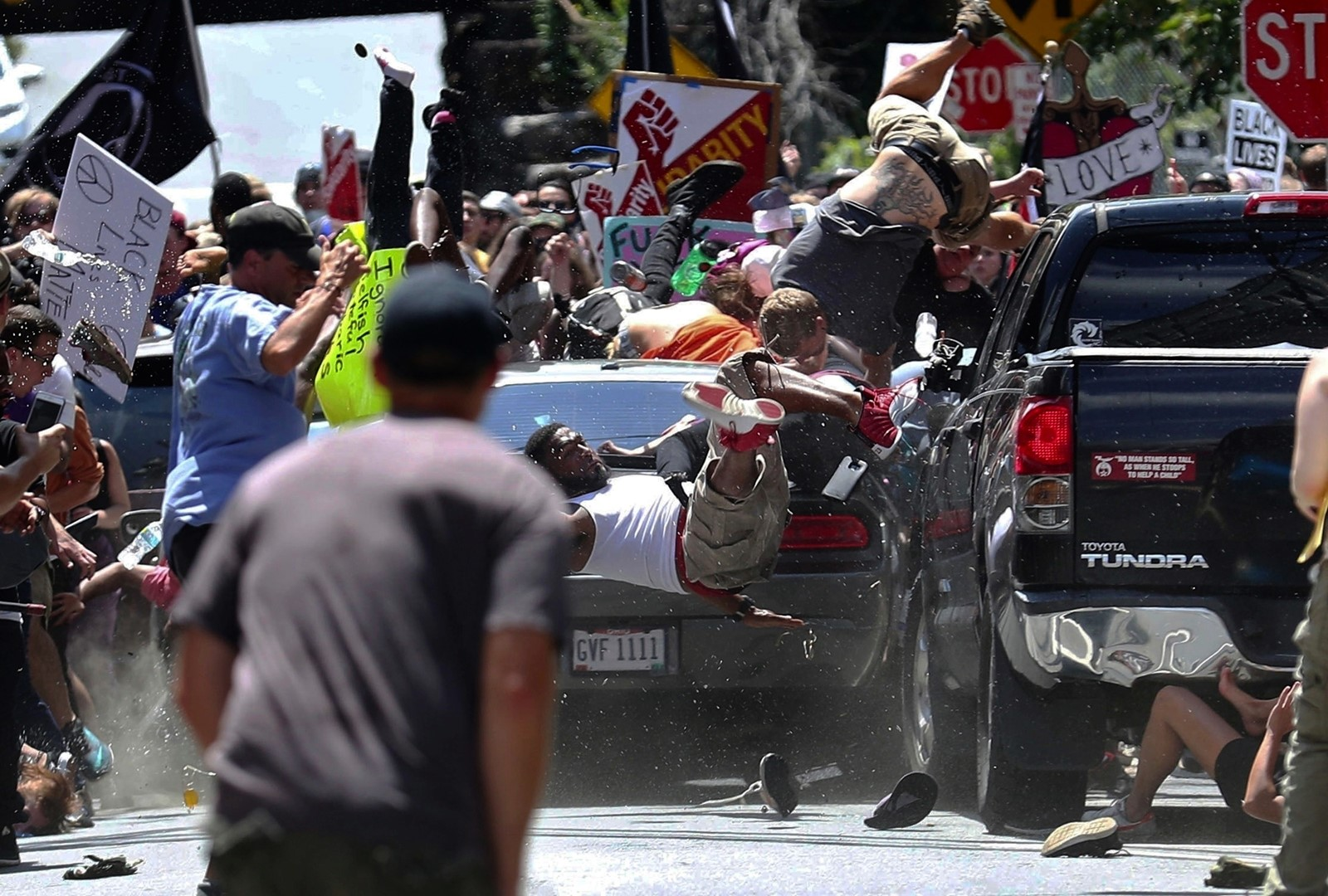 A car driven by James Alex Fields Jr. plows into people protesting a far-right rally in Charlottesville, Virginia, in 2017. Fields was sentenced to life in prison. — Photograph: Ryan M. Kelly/Daily Progress.