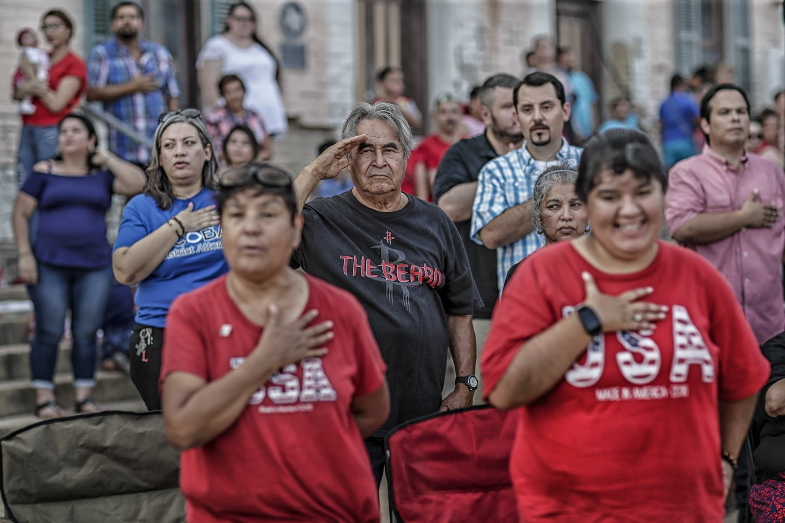Roma's Fourth of July festivities include patriotic prayers, fireworks and a Border Patrol booth where residents greet agents warmly. — Photograph: Robert Gauthier/Los Angeles Times.