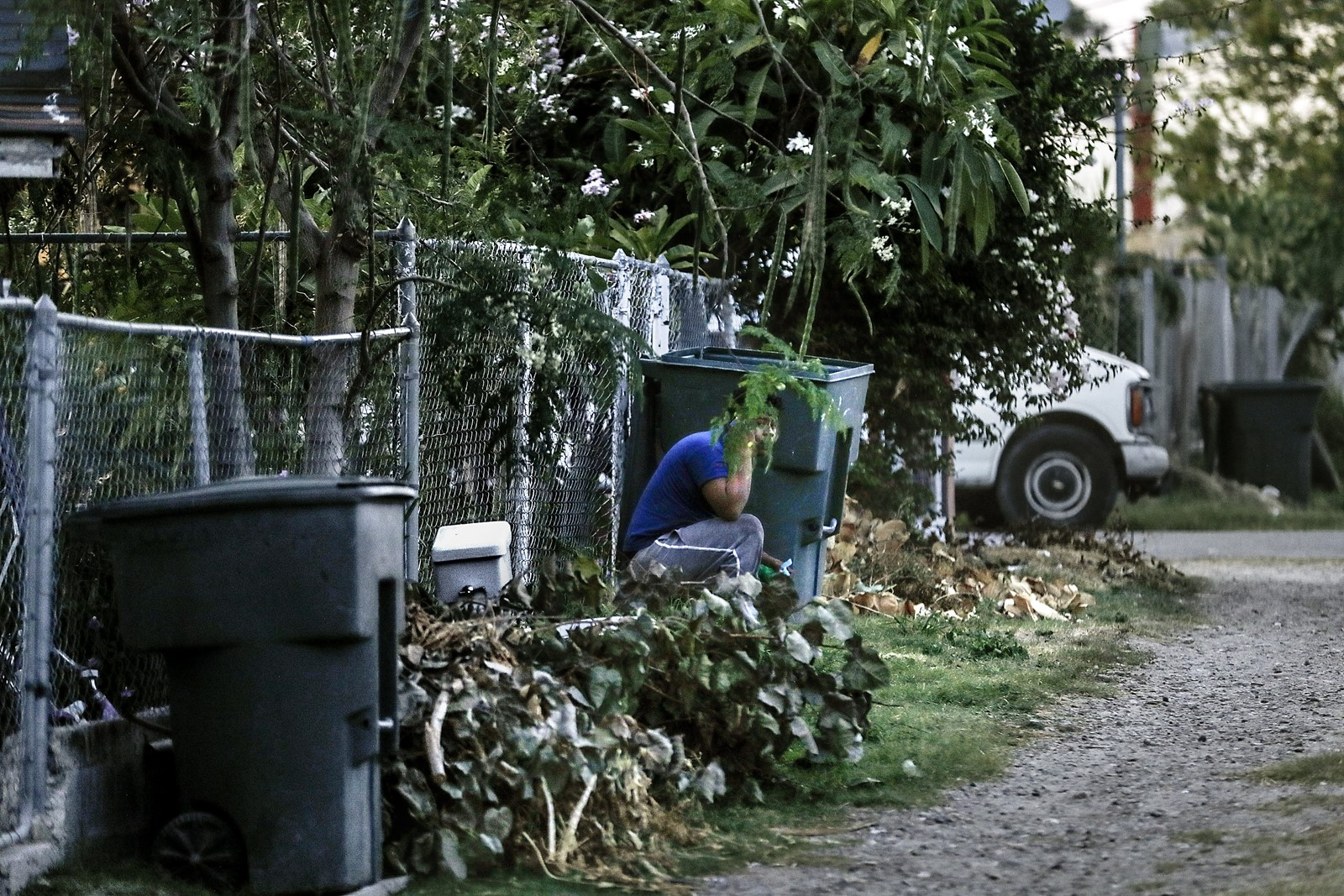 Eventually, the man huddles in an alleyway, using a cellphone, before heading toward a well-worn dirt path that ends at the home of a suspected smuggler. — Photograph: Robert Gauthier/Los Angeles Times.