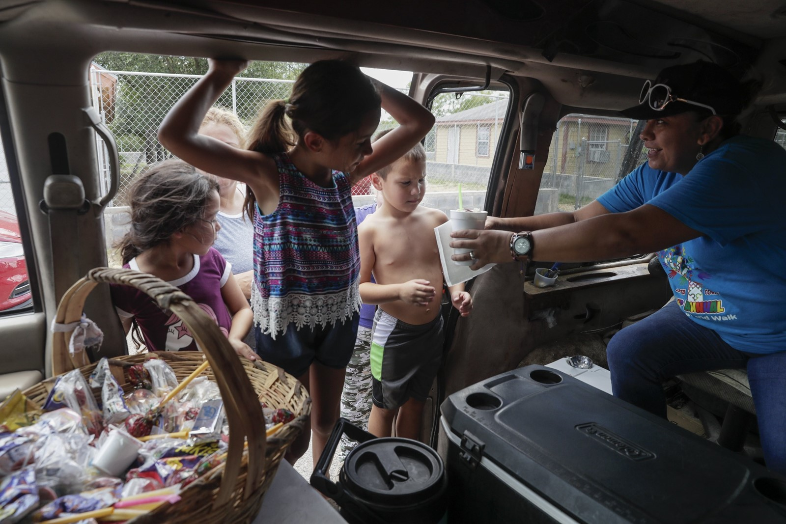 Children visit a truck for Mexican sweets. One teacher said students asked whether a wall would prevent them from reaching the river to fish. — Photograph: Robert Gauthier/Los Angeles Times.