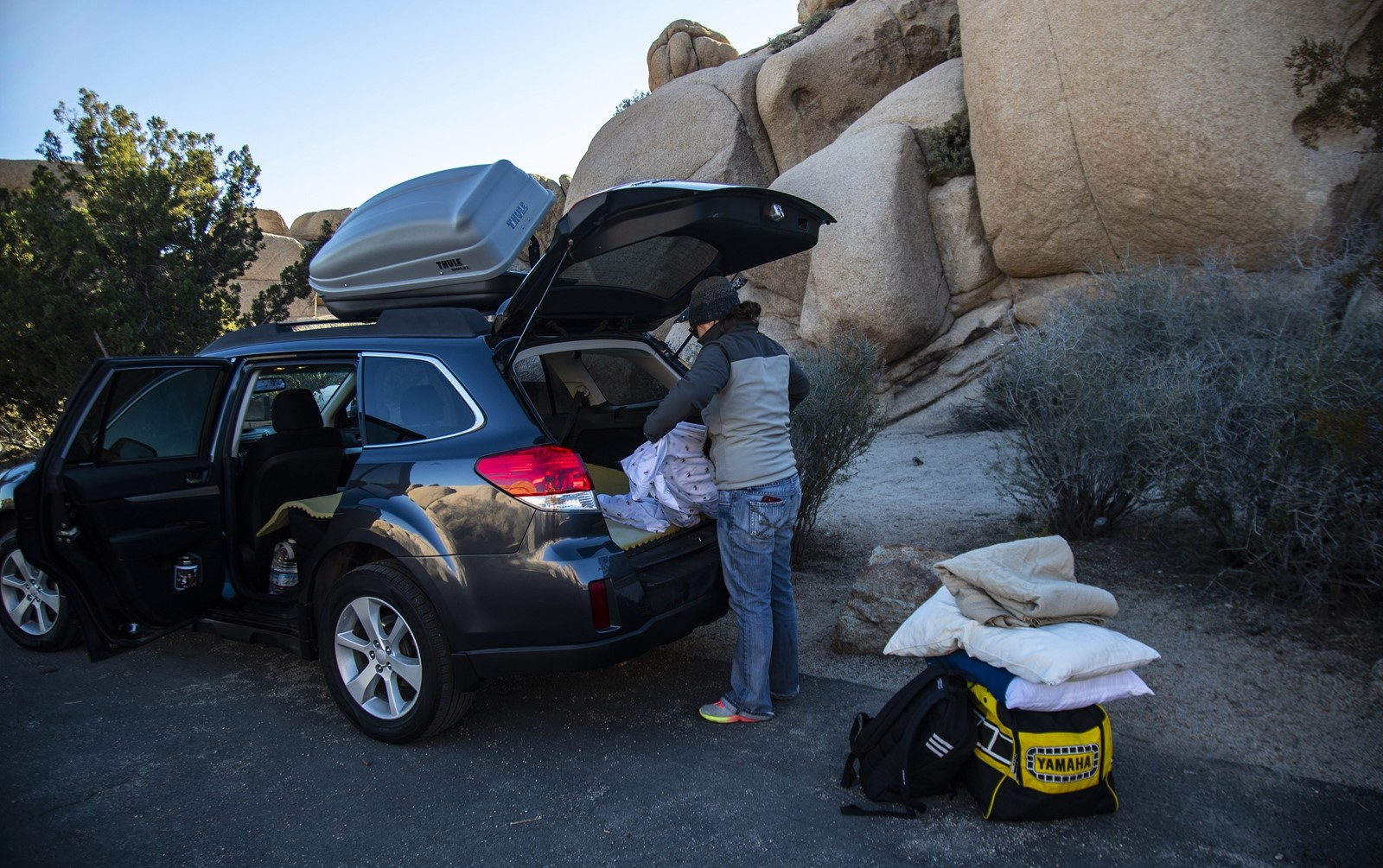 At Joshua Tree National Park, Natalie Elsman of Iowa packs her car at Jumbo Rocks after getting word on Tuesday that campgrounds were closing. — Photograph: Gina Ferazzi/Los Angeles Times.