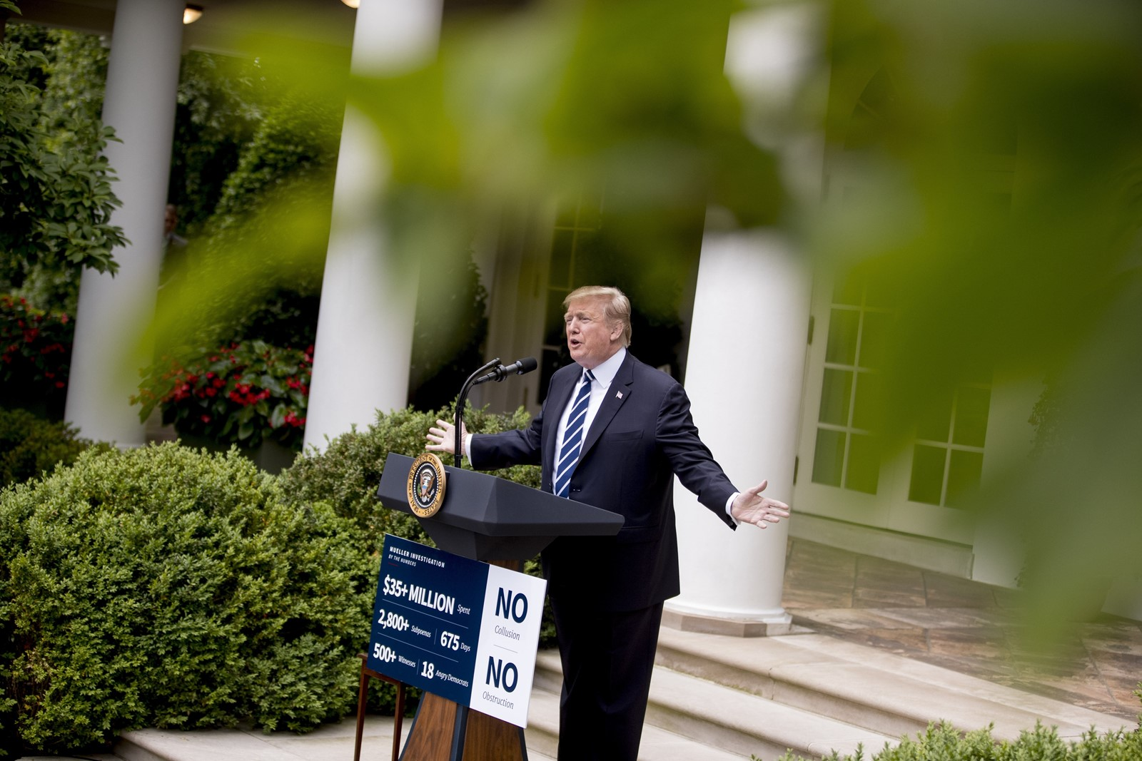 "President Donald J. Trump appears with a pre-made sign at a hastily called news conference after he stormed out of the White House meeting, saying bipartisan cooperation was impossible ""under these circumstances."" — Photograph: Andrew Harnik/Associated Press."