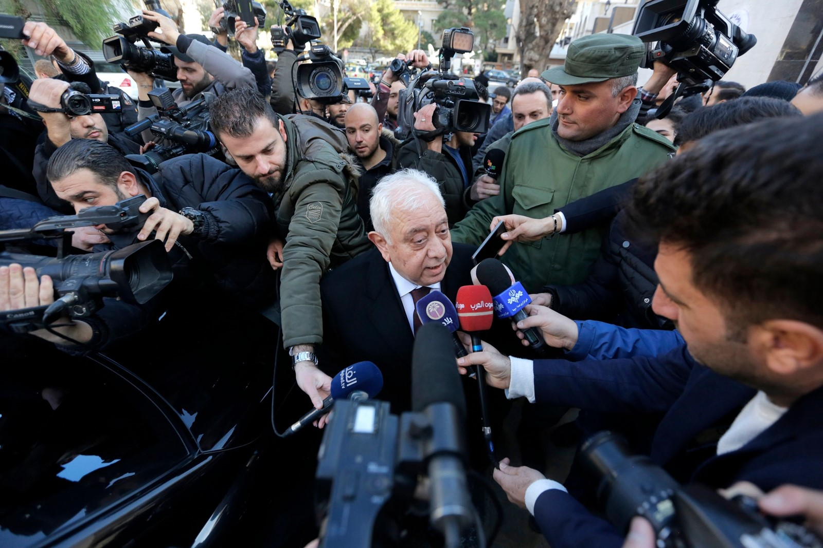 "Reporters interview Iraq's ambassador to Syria, Saed Mohammad Riad, at the reopening of the United Arab Emirates Embassy. UAE Charge d'Affaires Abdul Hakim Naimi said, ""This is a call to restore relations with Syria and open the embassies of other Arab nations."" — Photograph: Youssef Badawi/European Pressphoto Agency/Shutterstoc."